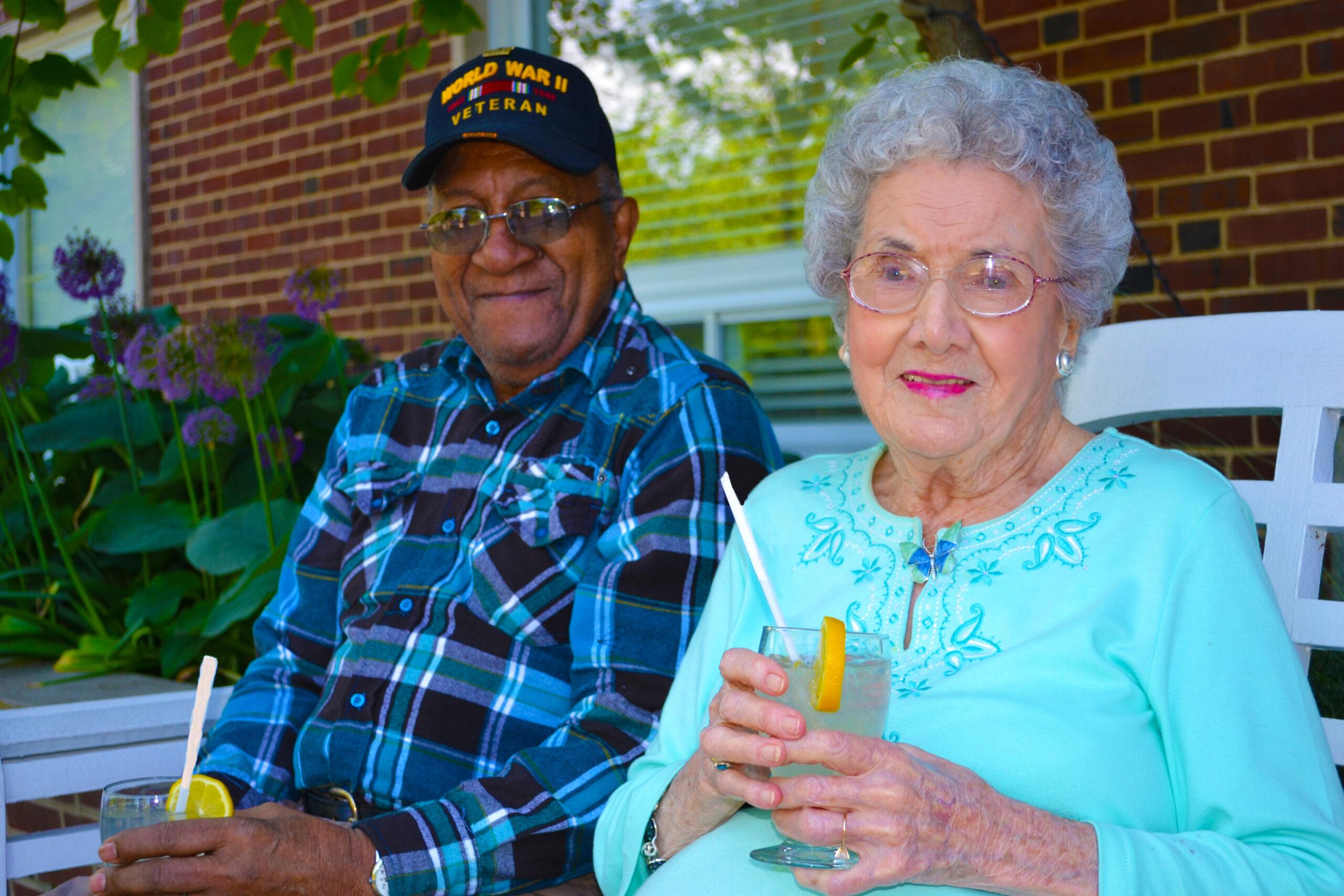 Elder Man and Woman Drinking Lemonade